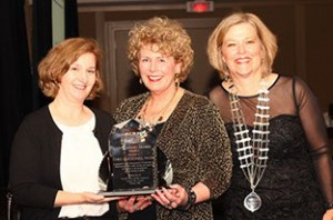 Chris MacDonell (center) receiving the ACRM Distinguished Member Award
