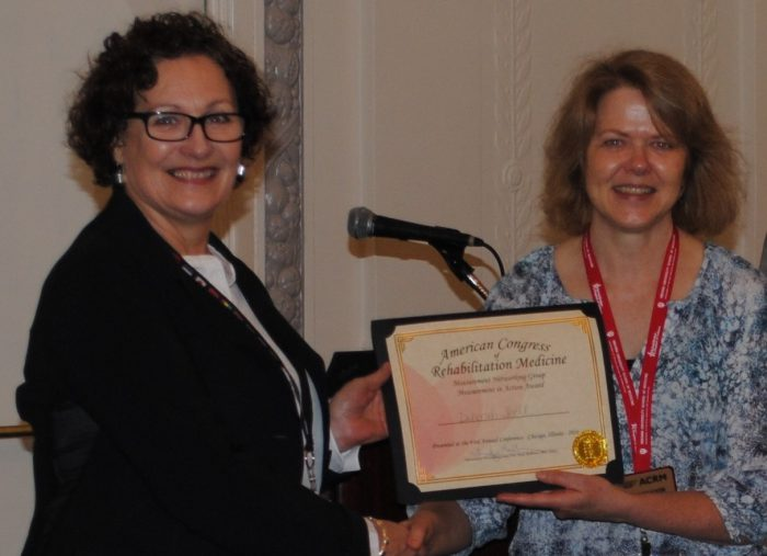 Trudy Mallinson, MNG Chair (right) presents poster award to Deborah Snell